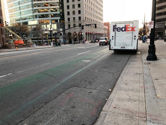 200 S in Salt Lake City between State and Main has deteriorated and needs a protected bike lane. Photo by Dave Iltis, Cycling Utah