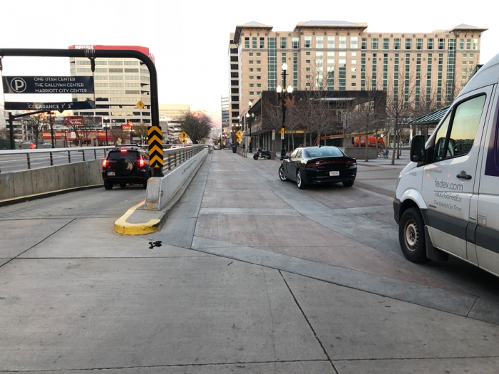 A protected bike lane could be placed here with a few signs and a jersey barrier. 200 S in Salt Lake City between State and Main has deteriorated and needs a protected bike lane. Photo by Dave Iltis, Cycling Utah