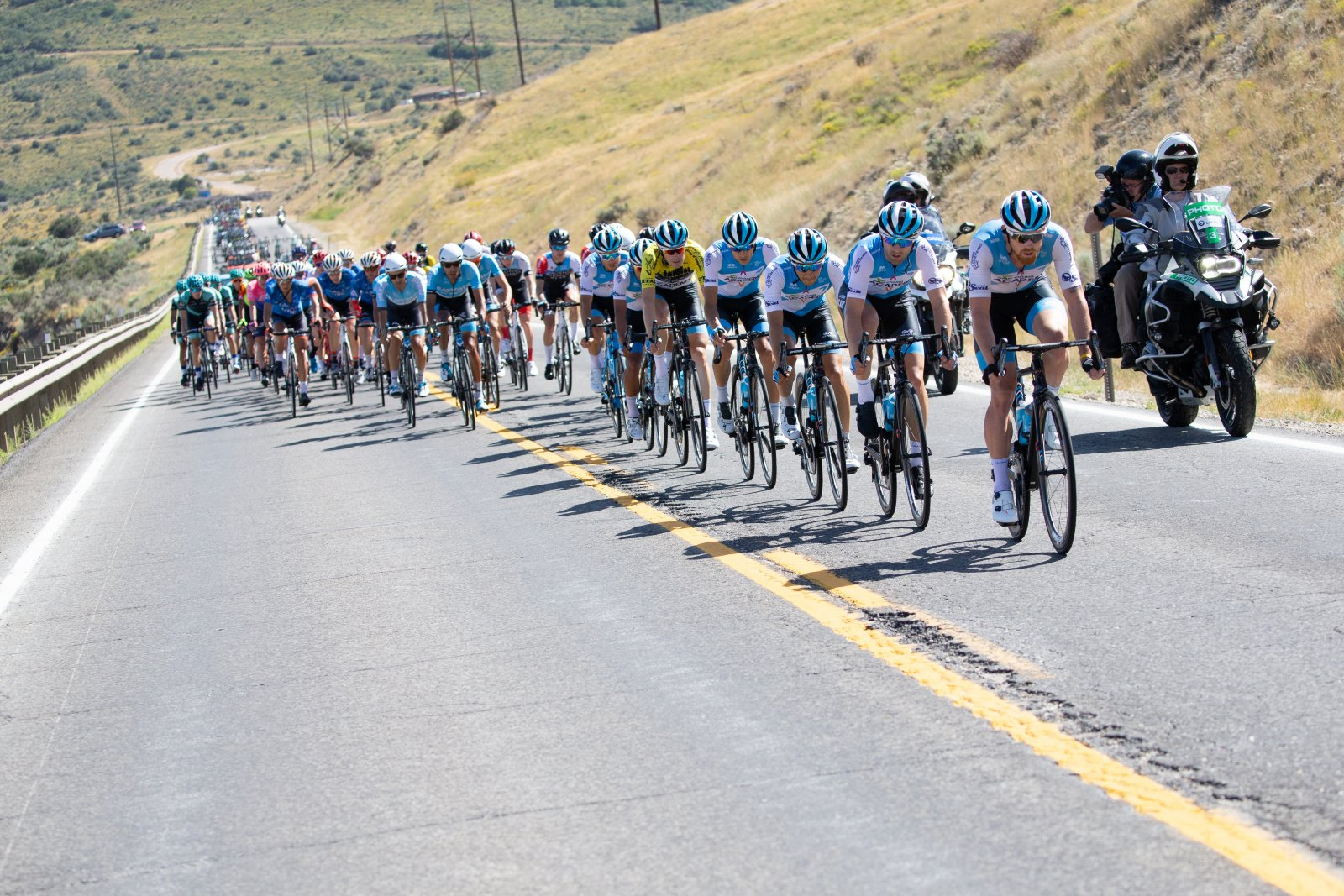 Israel Cycling Academy controls the front of the peloton.