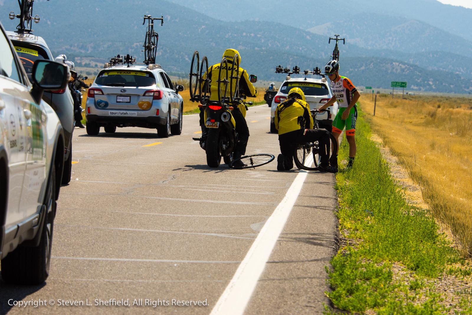A Bardiani rider in the break needs a rear wheel change.. Photo by Steven Sheffield