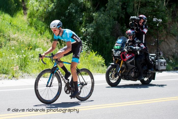 The TV moto follows Jordan Cheyne (Elevate-USA KHS Pro Cycling) up the steep climb during the Prologue at Snowbird, 2019 LHM Tour of Utah (Photo by Dave Richards, daverphoto.com)