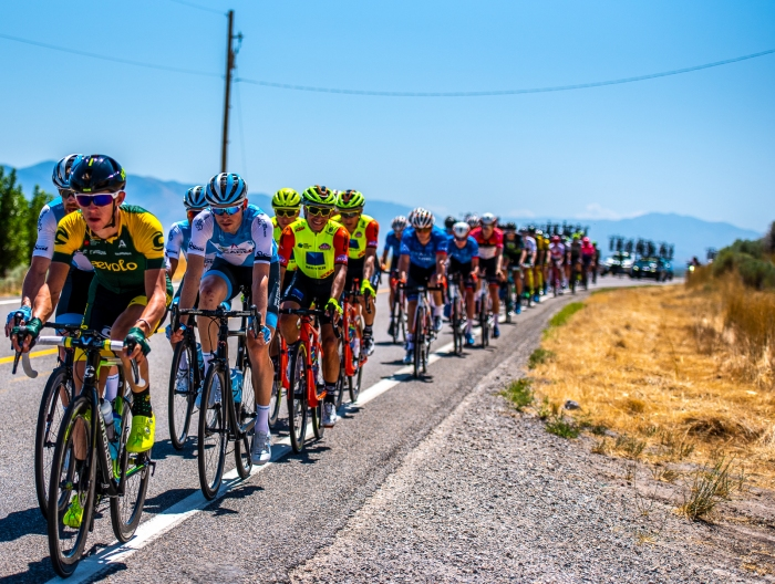 Some riders are serious in the bunch ... and some smile for the camera. Stage 1, Tour of Utah. Photo by Steven L. Sheffield