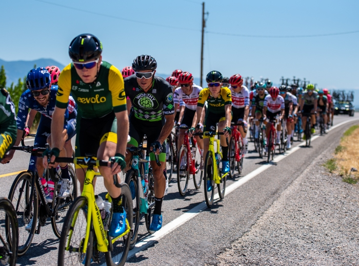 Alex Howes (EF Education First) and Travis McCable (Worthy Pro Cycling) sitting in the peloton behind a couple of Aevolo riders. Stage 1, 2019 Tour of Utah. Photo by Steven L. Sheffield