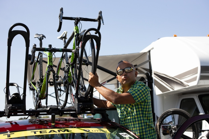 Jono Coulter putting one of the Aevolo bikes on top of the team car. Stage 2, 2019 Tour of Utah. Photo by Cathy Fegan-Kim