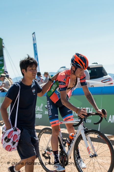 Nippo-Vini Fantini-Faizane soigneur tends to his exhausted rider at the finish of Stage 2 - Brigham City to Powder Mountain Resort, 2019 LHM Tour of Utah (Photo by Dave Richards, daverphoto.com)