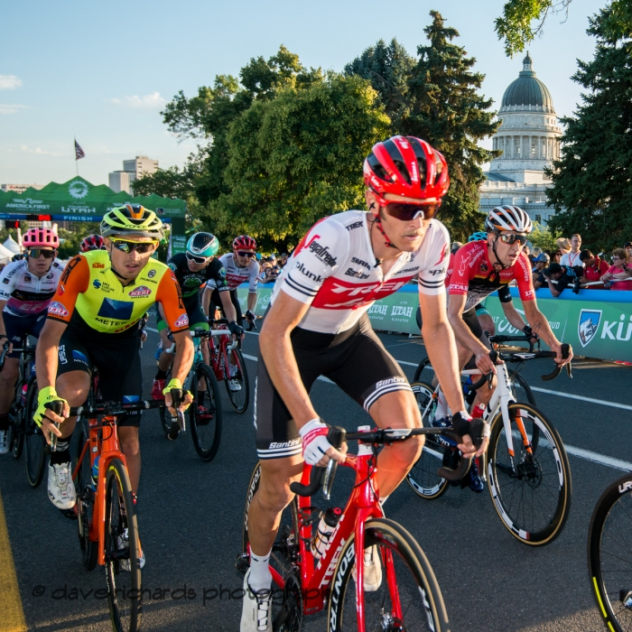 The peloton rolls through the start/finish line during one of the circuits on Stage 4 - Salt Lake City Circuit Race, 2019 LHM Tour of Utah (Photo by Dave Richards, daverphoto.com)