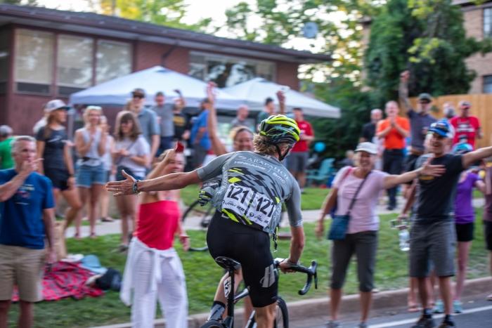 TJ Eisenhart (Arapahoe-Hincapie p/b BMC) high-fives fans on the last lap up State Street. Stage 4, 2019 Tour of Utah. Photo by Steven L. Sheffield