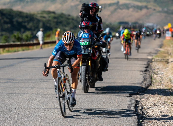 Evan Huffman (Rally UHC Cycling) drags his tongue on the ground as he crests the last KOM on the penultimate day of his career. Stage 5, 2019 Tour of Utah. Photo by Steven L. Sheffield