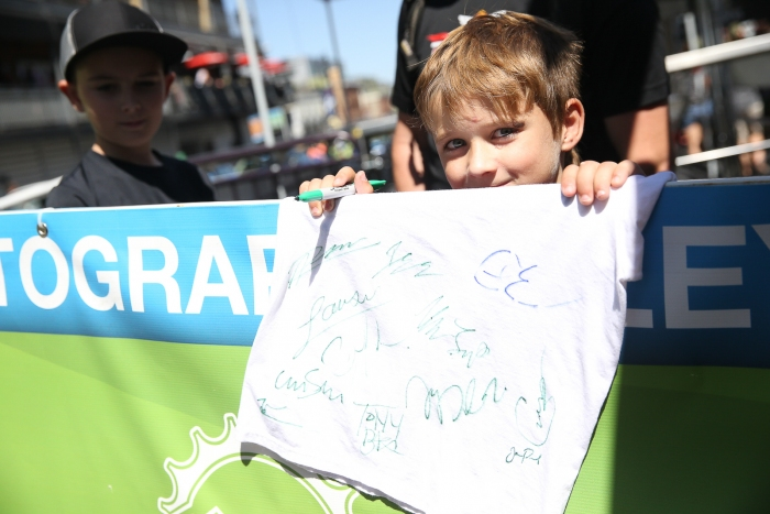 A happy young fan at Autograph Alley.