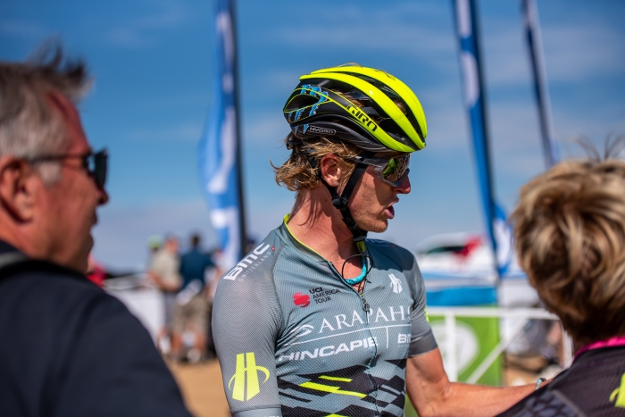 TJ Eisenhart (Arapahoe-Hincapie p/b BMC) chats with family after finishing the climb to Powder Mountain. Stage 2, 2019 Tour of Utah. Photo by Steven L. Sheffield