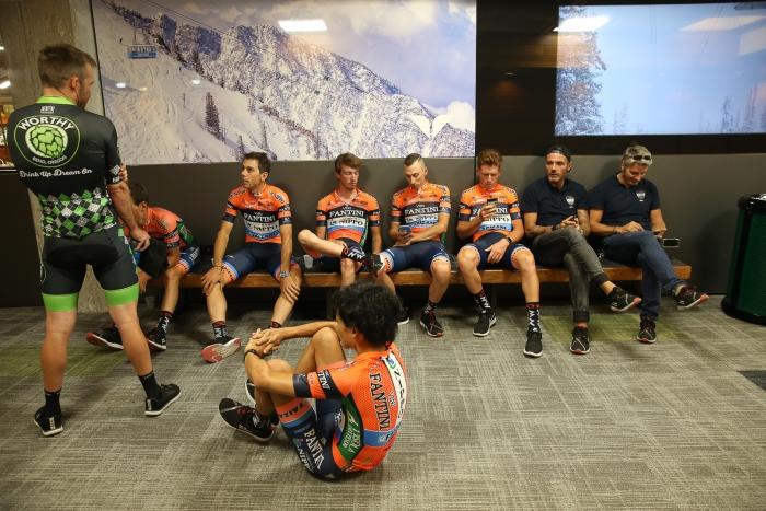 Riders of NIPPO-Vini Fantini-Faizane and Jonathon Clarke of Worthy Pro Cycling chill before Team Presentation.