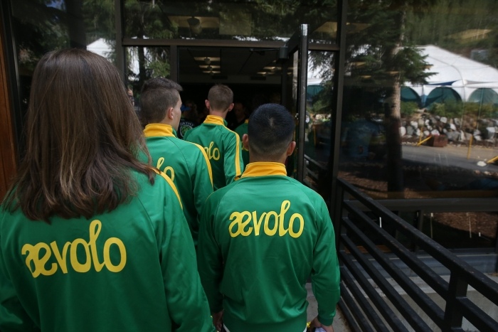 The Aevolo (USA) team awaits their turn on stage.