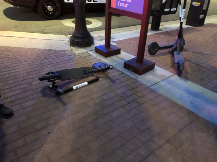 The aftermath of a car-Bird crash. The Bird was in the crosswalk. The rider had a little road rash. The police didn't take sides even though the scooter was in the crosswalk. E-Scooters and bikes in Salt Lake City, Utah. Photo by Dave Iltis