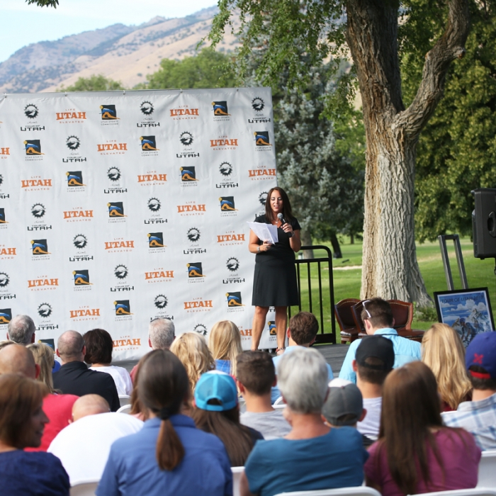 Tour of Utah organizer Jenn Andrs addresses the crowd. Photo: Catherine Fegan-Kim
