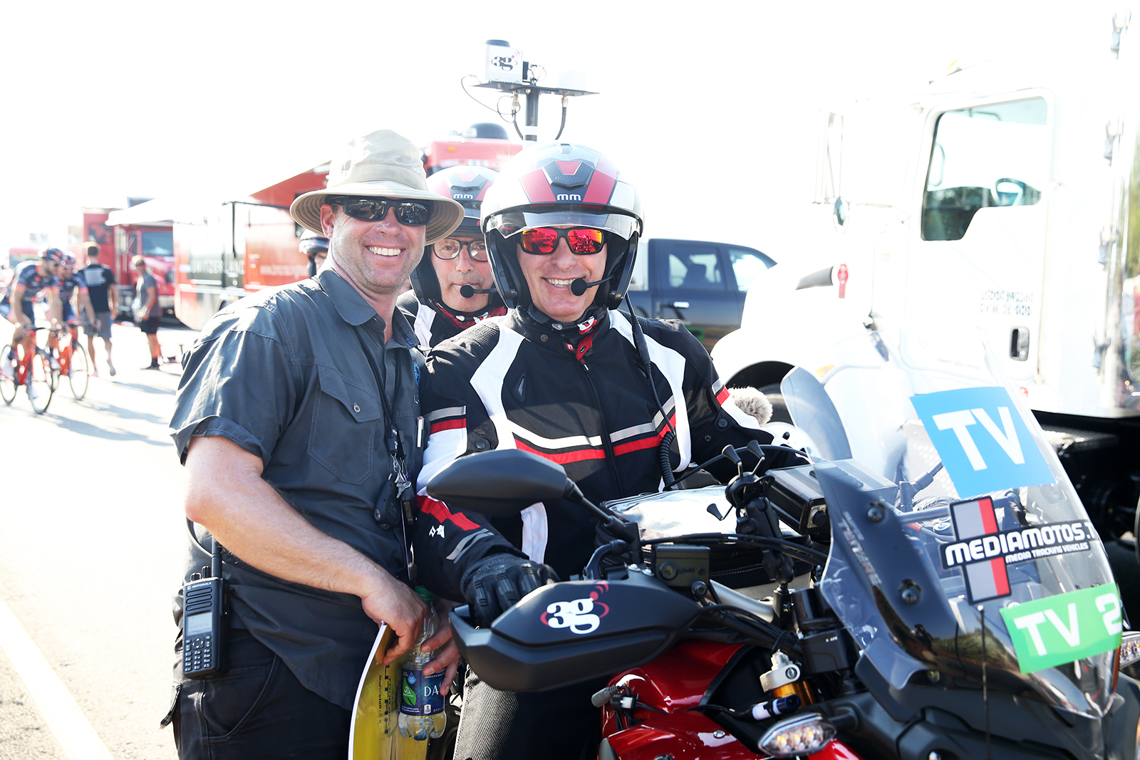 TV crew and Regulator, Tim Schaars poses for a quick photo.  2018 Tour of Utah Team Prologue, August 6, 2018, St. George, Utah. Photo by Cathy Fegan-Kim, cottonsoxphotography.net
