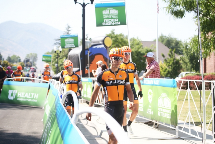 Silber racers heads to the stage for sign-in. 2018 Tour of Utah Stage 2, August 8, 2018, Payson, Utah. Photo by Cathy Fegan-Kim, cottonsoxphotography.net