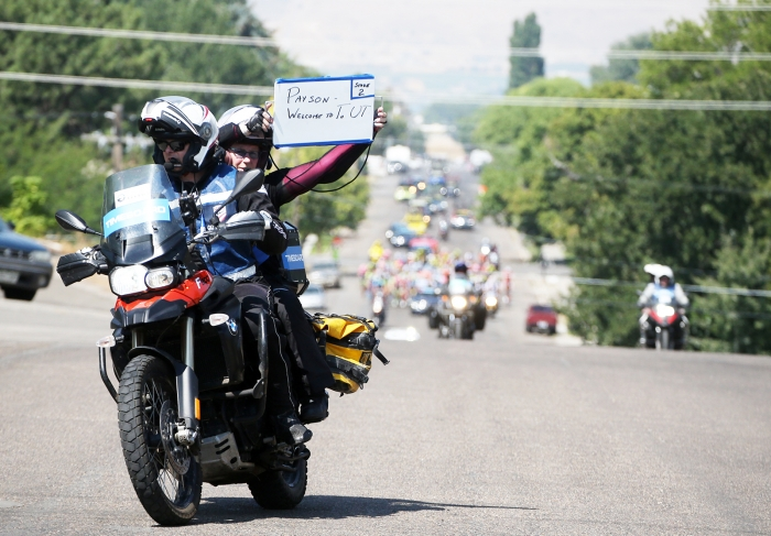 Time Board, Cindy Yorgason with a message to Payson. 2018 Tour of Utah Stage 2, August 8, 2018, Payson, Utah. Photo by Cathy Fegan-Kim, cottonsoxphotography.net