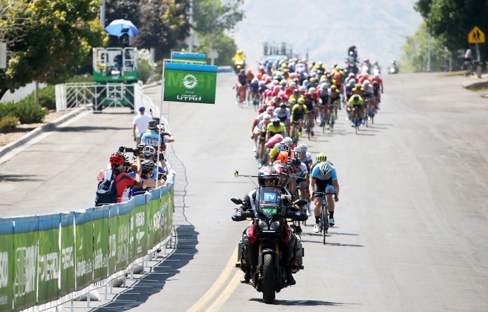 The peloton goes through the Start/Finish for the second time after racing for a while. 2018 Tour of Utah Stage 2, August 8, 2018, Payson, Utah. Photo by Cathy Fegan-Kim, cottonsoxphotography.net