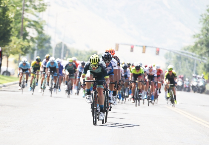 303 Project rider animating the race. 2018 Tour of Utah Stage 2, August 8, 2018, Payson, Utah. Photo by Cathy Fegan-Kim, cottonsoxphotography.net