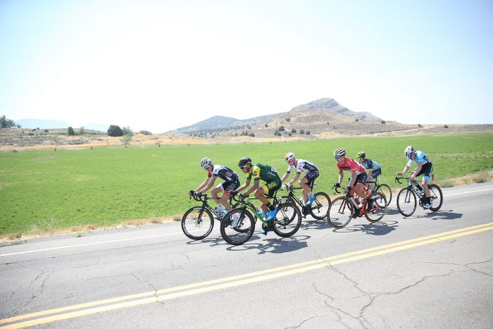 The break rides through the countryside. 2018 Tour of Utah Stage 2, August 8, 2018, Payson, Utah. Photo by Cathy Fegan-Kim, cottonsoxphotography.net