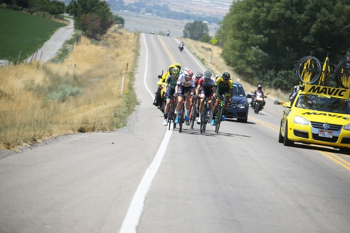 Mavic neutral support offers water to the riders in the break. 2018 Tour of Utah Stage 2, August 8, 2018, Payson, Utah. Photo by Cathy Fegan-Kim, cottonsoxphotography.net