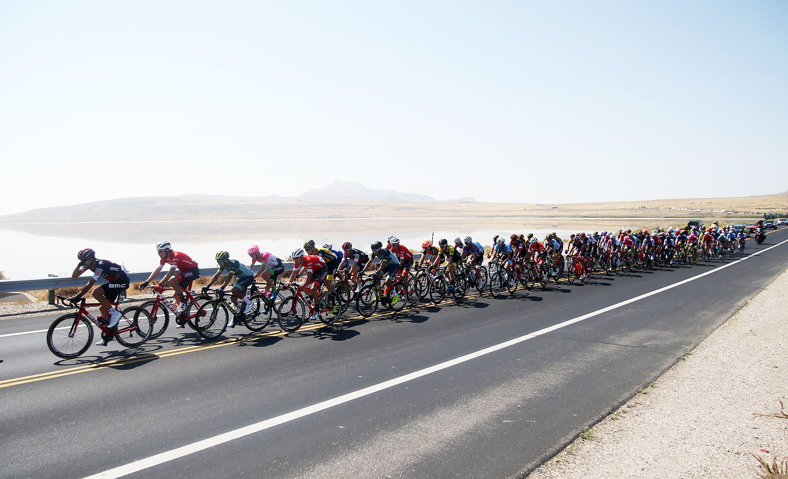 The peloton heads to the Bountiful Benches from Antelope Island. 2018 Tour of Utah Stage 3, August 8, 2018, Layton, Utah. Photo by Cathy Fegan-Kim, cottonsoxphotography.net