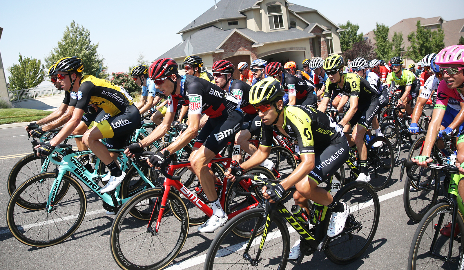 Peloton rides up the neighbourhood.  2018 Tour of Utah Stage 3, August 8, 2018, Layton, Utah. Photo by Cathy Fegan-Kim, cottonsoxphotography.net