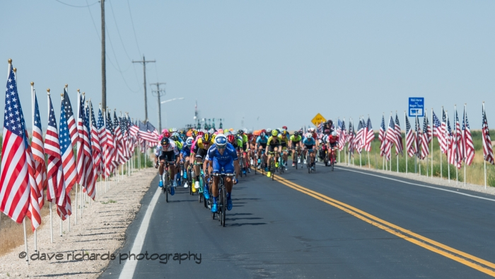 The peloton is greeted by American flags. Stage 3 Antelope Island to Layton, 2018 LHM Tour of Utah cycling race (Photo by Dave Richards, daverphoto.com)