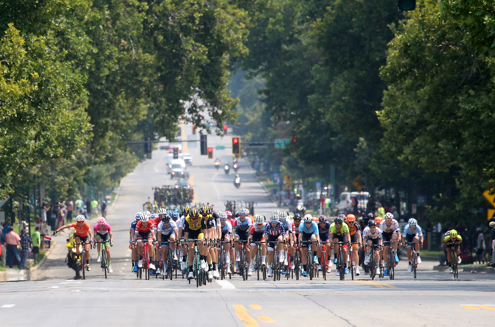 The peloton charges through Downtown SLC. 2018 Tour of Utah Stage 4, August 8, 2018, Salt Lake City, Utah. Photo by Cathy Fegan-Kim, cottonsoxphotography.net