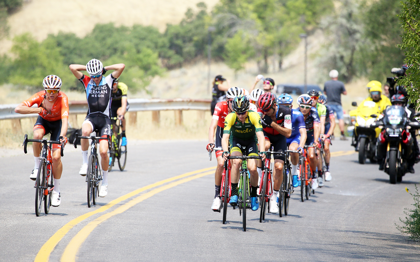 The break gets ice socks and some talks to there DSs via race radio. 2018 Tour of Utah Stage 4, August 8, 2018, Salt Lake City, Utah. Photo by Cathy Fegan-Kim, cottonsoxphotography.net