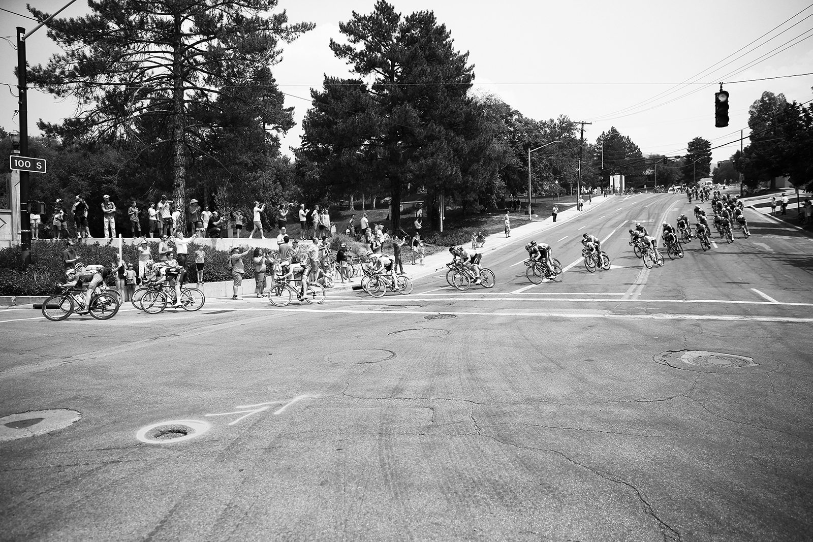 The peloton went through thie corner of Reservoir Park at high speed.  2018 Tour of Utah Stage 4, August 8, 2018, Salt Lake City, Utah. Photo by Cathy Fegan-Kim, cottonsoxphotography.net