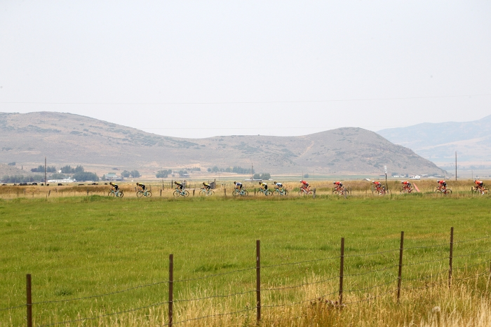 The peloton cruises through the roads between big fields of green.  Stage 5 of the 2018 Tour of Utah, August 10, 2018. Photo by Cathy Fegan-Kim, www.cottonsoxphotography.net