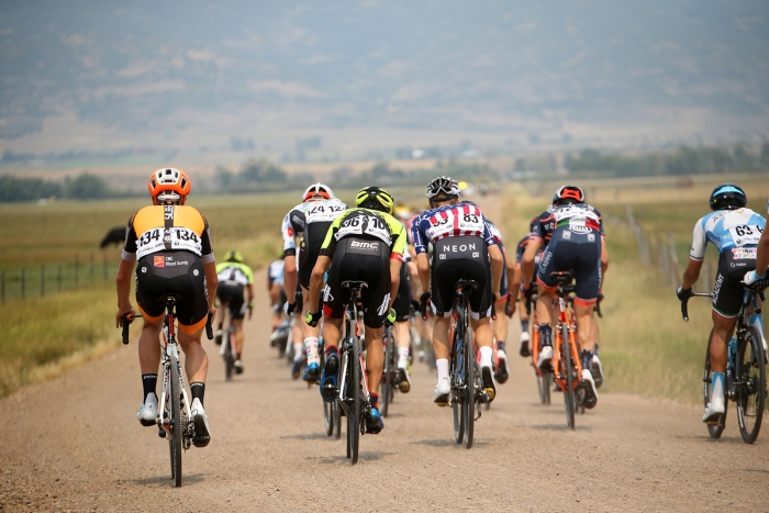The peloton charges through Democrat Alley.  Stage 5 of the 2018 Tour of Utah, August 10, 2018. Photo by Cathy Fegan-Kim, www.cottonsoxphotography.net