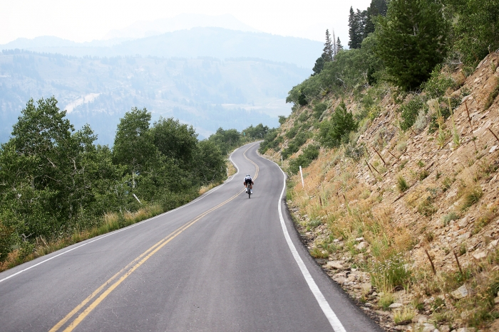 A rider descends Guardsman Pass. Stage 5 of the 2018 Tour of Utah, August 10, 2018. Photo by Cathy Fegan-Kim, www.cottonsoxphotography.net