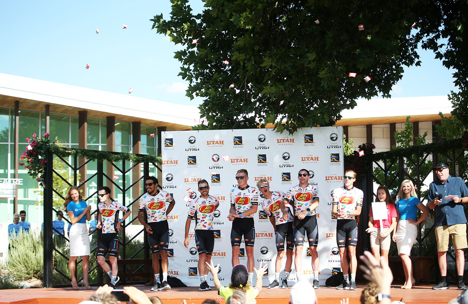 Making it rain with Jelly Belly - the team is always a Team Presenation favorite.  2018 Tour of Utah Team Presentation, August 4, 2018, Cedar City, Utah. Photo by Cathy Fegan-Kim, cottonsoxphotography.net