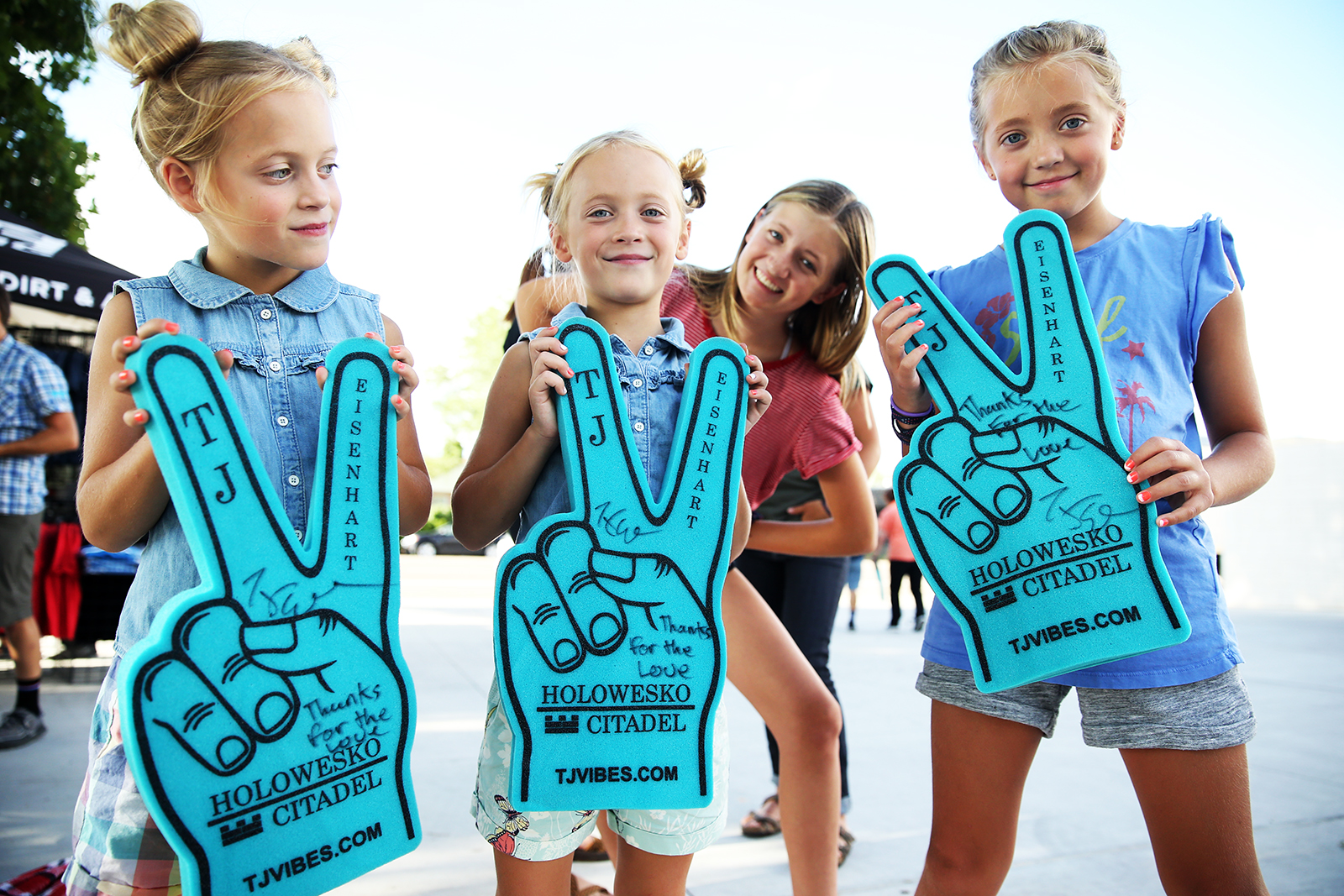 Happy young fans with an autograph and message: Thanks for the love from TJ Eisenhart. 2018 Tour of Utah Team Presentation, August 4, 2018, Cedar City, Utah. Photo by Cathy Fegan-Kim, cottonsoxphotography.net