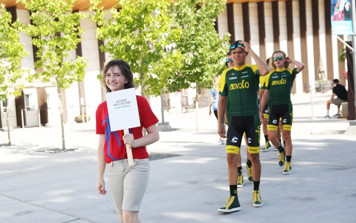 Young volunteers were excited to escort the teams onto the Team Presentation stage.  2018 Tour of Utah Team Presentation, August 4, 2018, Cedar City, Utah. Photo by Cathy Fegan-Kim, cottonsoxphotography.net
