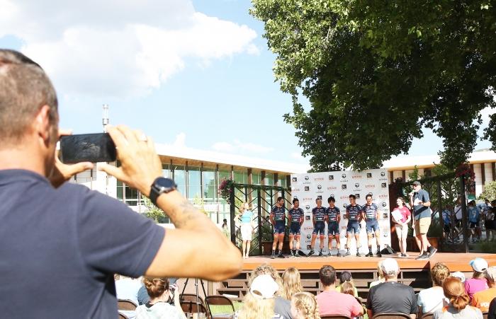 The Directeur Sportif of Nipoo-Vini Fantini-Europa Ovini multi tasks taking photos for their team social media.  2018 Tour of Utah Team Presentation, August 4, 2018, Cedar City, Utah. Photo by Cathy Fegan-Kim, cottonsoxphotography.net