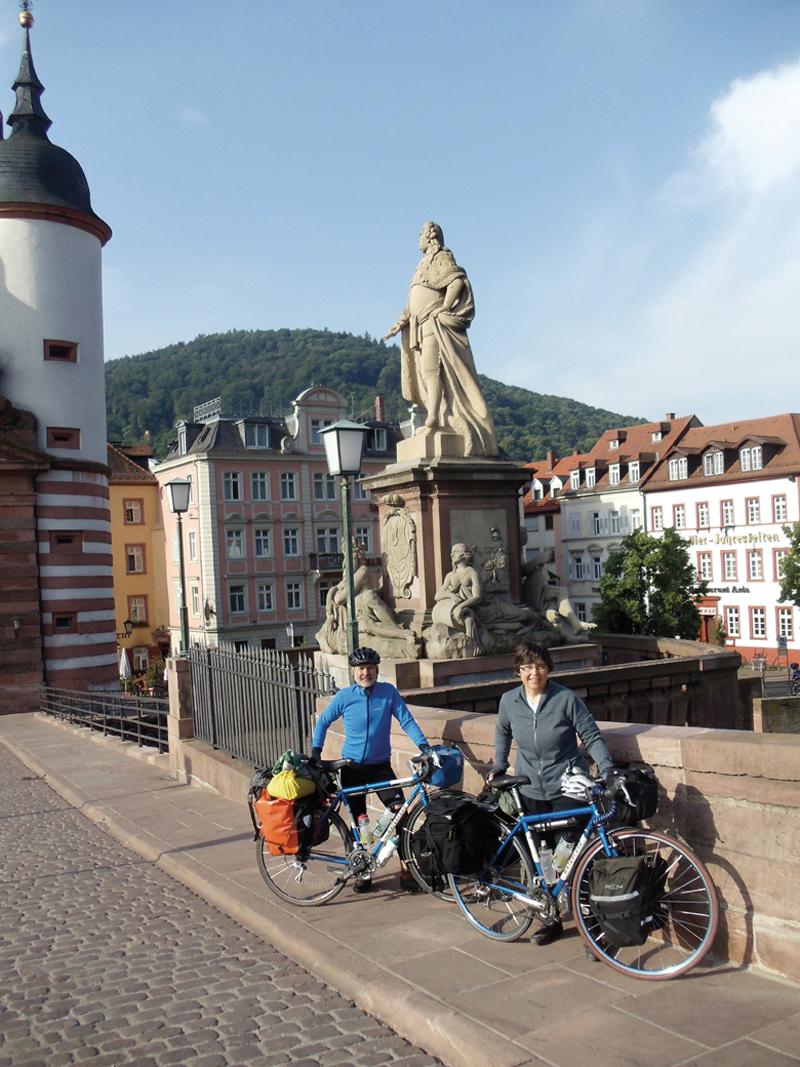 Bicycle touring City of Heidelberg bridge to the famous Heidelberg Castle.