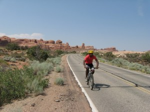 Riding Bicycle Through Arches National Park