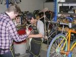 Mechanics Working On Bicycle