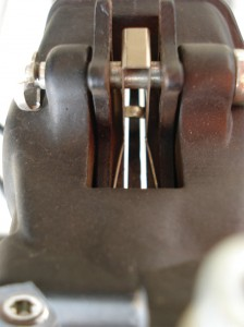 room between the brake pads and the disc rotor.
