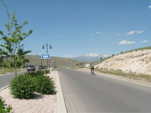 A rider crests Unity Pass in Eagle Mountain, with Mount Timpanogos towering in the distance.