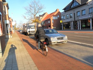 A older rider on a cycletrack in Belgium.