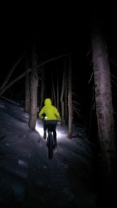 Kaitlin Barklow rides Wasatch Crest Trail in the snow at night.