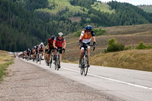 Larry Peterson (69 years old) leading group of several cyclists up the Salt River Pass climb.