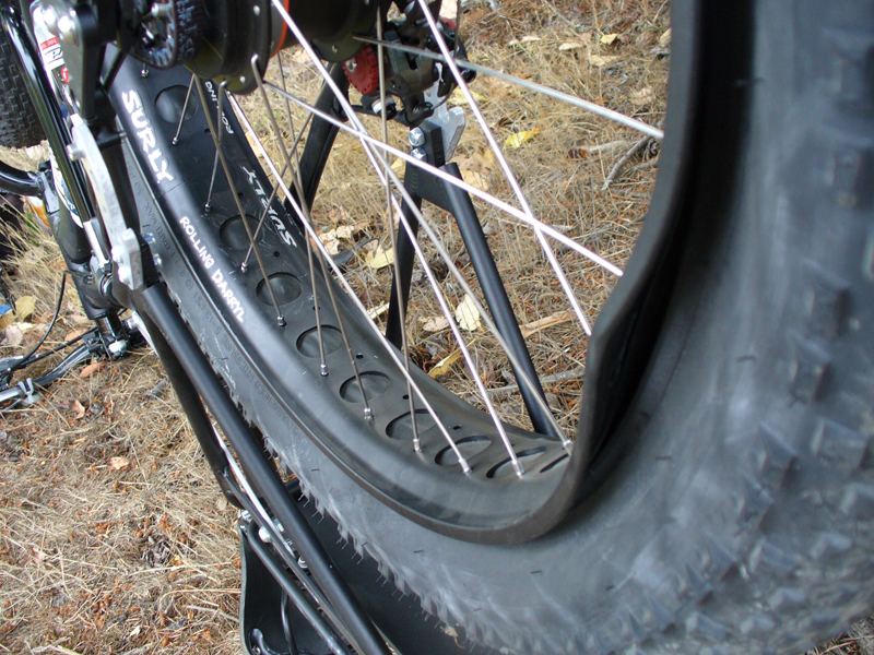 Dented rim; upended to change a rear flat near Blyn.