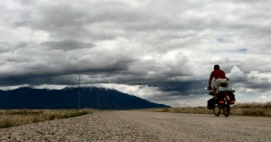 I'm south of Montello, Nevada, riding on nice county roads towards the Pilot Range. The clouds that had