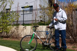 Salir Omer, 19, is a refugee who received a bicycle from the Salt Lake