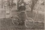 A woman with a bike.